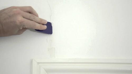 reparar fissuras nas paredes